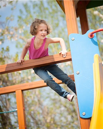 preteen girl - Young girl climbing on childrens playground Stock Photo - Premium Royalty-Free, Code: 693-06967450