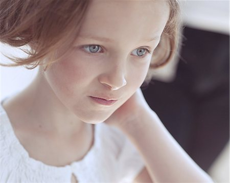 preteen girls faces photo - Close-up portrait of young girl looking away from camera Stock Photo - Premium Royalty-Free, Code: 693-06967466