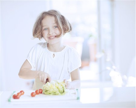 preteen girls faces photo - Young girl making a salad Stock Photo - Premium Royalty-Free, Code: 693-06967467