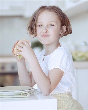 preteen girls faces photo - Beautiful Young Girl eating sandwich Stock Photo - Premium Royalty-Free, Code: 693-06967474