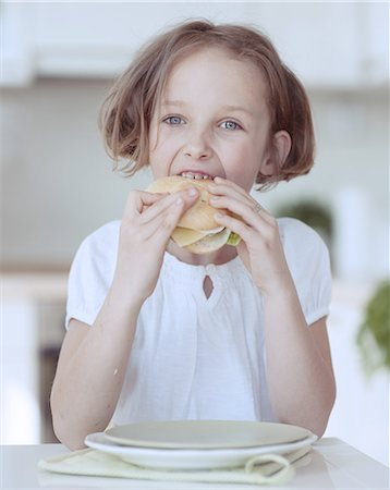 preteen girls faces photo - Young girl eating cheese sandwich Stock Photo - Premium Royalty-Free, Code: 693-06967475