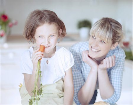 preteen girls faces photo - Young girl eating carrot Stock Photo - Premium Royalty-Free, Code: 693-06967477