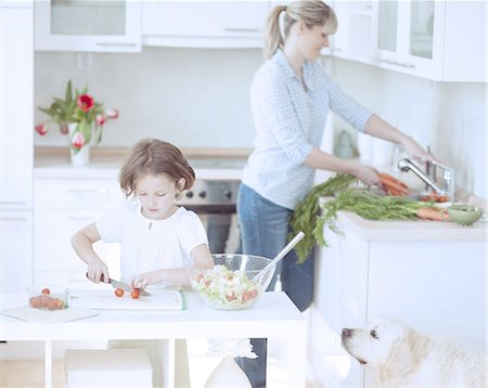 Mother and Daughter (8-9) preparing healthy meal in kitchen Stock Photo - Premium Royalty-Free, Code: 693-06967471