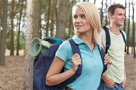 Beautiful young woman with man trekking in forest Stock Photo - Premium Royalty-Free, Code: 693-07444484