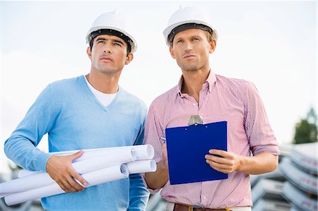 safety - Architects with blueprint and clipboard standing at site Stock Photo - Premium Royalty-Free, Code: 693-07456137