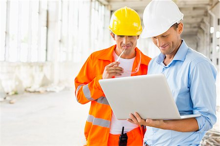 safety - Male architects using laptop at construction site Stock Photo - Premium Royalty-Free, Code: 693-07456158