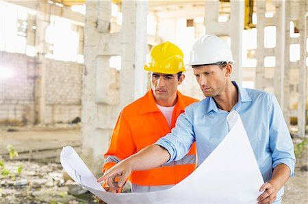 designs - Male architects discussing over blueprint at construction site Stock Photo - Premium Royalty-Free, Code: 693-07456162