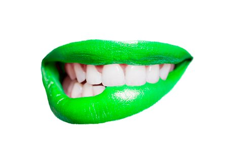 Close-up of teeth biting green lip over white background Stock Photo - Premium Royalty-Free, Code: 693-07456328