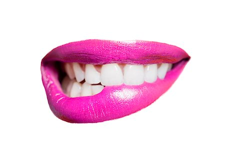 Close-up of teeth biting pink lip over white background Stock Photo - Premium Royalty-Free, Code: 693-07456329
