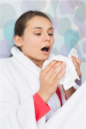 people coughing or sneezing - Young woman suffering from cold sneezing at home Stock Photo - Premium Royalty-Free, Code: 693-07456398