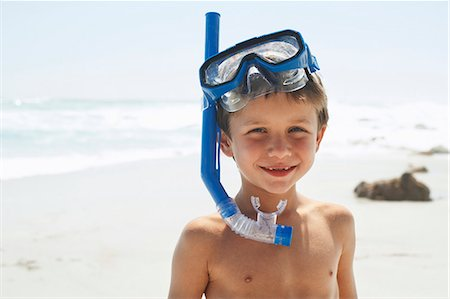 Boy With Snorkel on Beach Stock Photo - Premium Royalty-Free, Code: 693-07456493