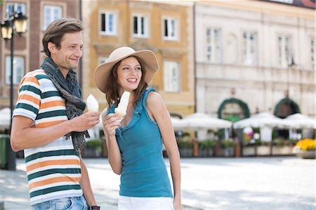 eating ice cream - Tourist couple enjoying ice cream cones during vacation Stock Photo - Premium Royalty-Free, Code: 693-07542197