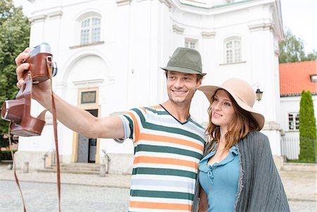retro - Tourist couple taking self portrait outside St. Casimir Church, Warsaw, Poland Stock Photo - Premium Royalty-Free, Code: 693-07542198