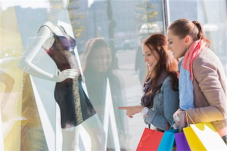 Young female friends window shopping Stock Photo - Premium Royalty-Free, Code: 693-07542259