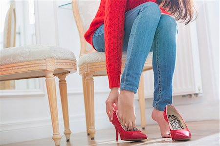 Low section of woman trying on footwear in store Stock Photo - Premium Royalty-Free, Code: 693-07542268