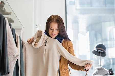 fashion - Young woman choosing sweater in store Stock Photo - Premium Royalty-Free, Code: 693-07542285