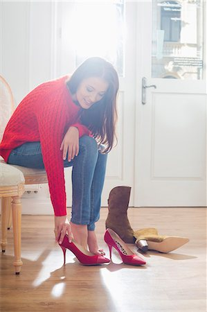 selecting - Woman trying on footwear in store Stock Photo - Premium Royalty-Free, Code: 693-07542296