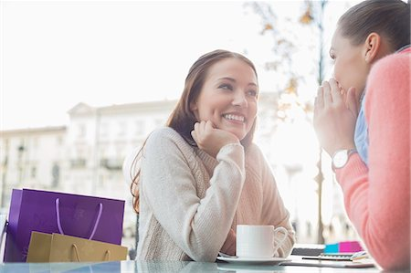 Happy female friends gossiping at outdoor cafe Stock Photo - Premium Royalty-Free, Code: 693-07542315