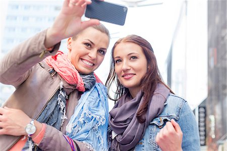 person - Women in jackets taking self portrait through mobile phone Stock Photo - Premium Royalty-Free, Code: 693-07542324