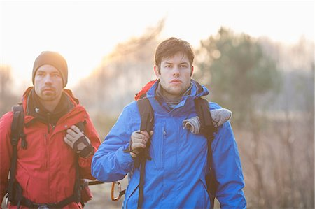 Young male hikers looking away in field Stock Photo - Premium Royalty-Free, Code: 693-07672996