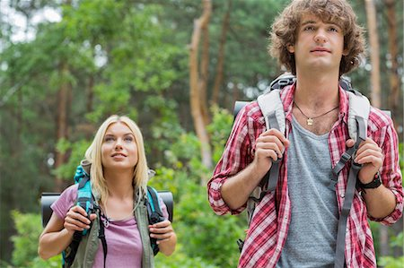 Young hiking couple looking away in forest Stock Photo - Premium Royalty-Free, Code: 693-07673125