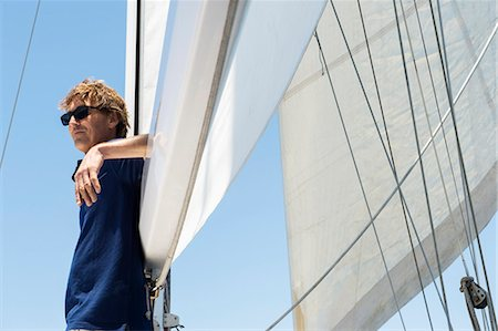 Side view of middle-aged man on yacht Stock Photo - Premium Royalty-Free, Code: 693-07912188