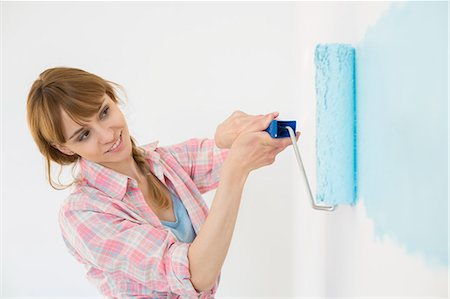 diy or home improvement - Beautiful woman painting wall with paint roller Stock Photo - Premium Royalty-Free, Code: 693-07912652