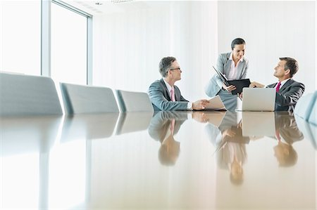 standing - Business people in meeting Stock Photo - Premium Royalty-Free, Code: 693-07913192