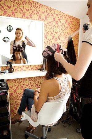 Female hairdresser spraying hairspray in customer's hair Stock Photo - Premium Royalty-Free, Code: 693-08127511