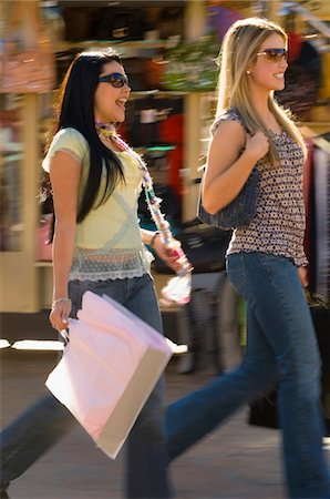 Stylish friends with shopping bags, outdoors Stock Photo - Premium Royalty-Free, Code: 693-03299817
