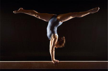 preteen girl feet - Gymnast (13-15) doing split handstand on balance beam, side view Stock Photo - Premium Royalty-Free, Code: 693-03299898