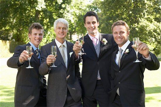 Four men toasting at wedding, portrait Stock Photo - Premium Royalty-Free, Image code: 693-03304881