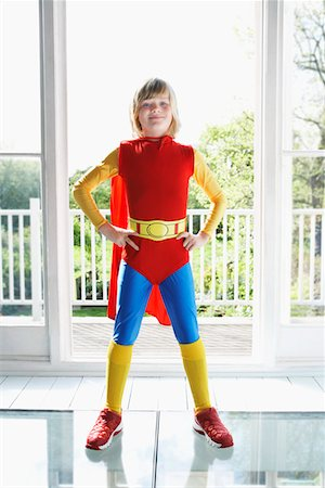 Portrait of young boy (7-9) posing in superhero costume with hands on hip Stock Photo - Premium Royalty-Free, Code: 693-03307197