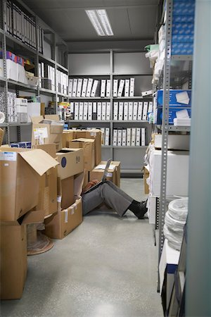 Woman using laptop, sitting on floor between boxes in storage room Stock Photo - Premium Royalty-Free, Code: 693-03307952