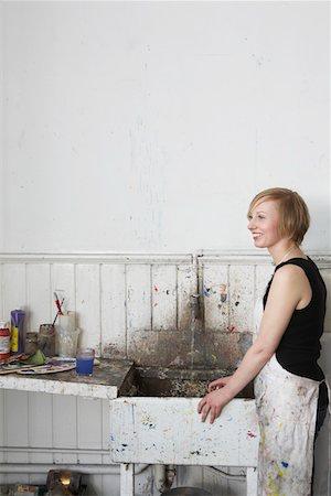 Artist standing by sink in studio Stock Photo - Premium Royalty-Free, Code: 693-03309435