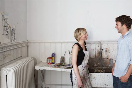 Two college students chatting by sink in art studio Stock Photo - Premium Royalty-Free, Code: 693-03309444