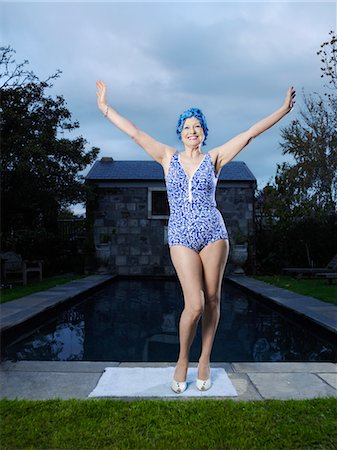 seniors and swim cap - Senior woman posing by pool, (portrait) Stock Photo - Premium Royalty-Free, Code: 693-03300700