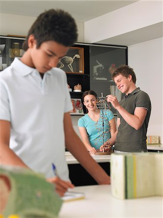Teenagers working in science class Stock Photo - Premium Royalty-Free, Code: 693-03300778