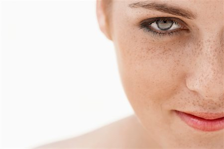 Young woman with freckles, close-up, cropped Stock Photo - Premium Royalty-Free, Code: 693-03301411