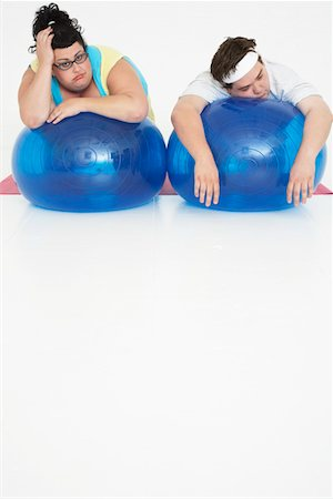 fat man exercising - Overweight Man and Woman with Exercise Balls Stock Photo - Premium Royalty-Free, Code: 693-03302956