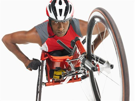 paraplegic male model - Paraplegic cycler, low angle view Stock Photo - Premium Royalty-Free, Code: 693-03302966