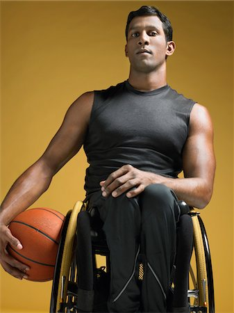 paraplegic male model - Paraplegic athlete sitting in wheelchair holding basketball Stock Photo - Premium Royalty-Free, Code: 693-03302973