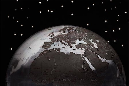 Globe against starry sky, cropped Stock Photo - Premium Royalty-Free, Code: 693-03303023