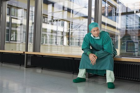 Pensive Physician sitting in hospital corridor Stock Photo - Premium Royalty-Free, Code: 693-03303193
