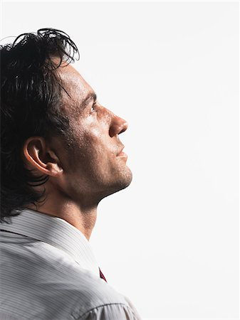 sweaty businessman - Tired Young Businessman staring into space, profile Stock Photo - Premium Royalty-Free, Code: 693-03303428