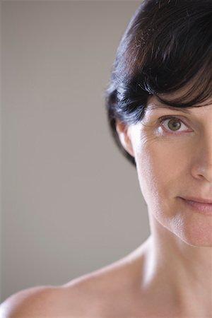 Mid adult woman wearing bra Stock Photo - Premium Royalty-Free, Code: 693-03314505