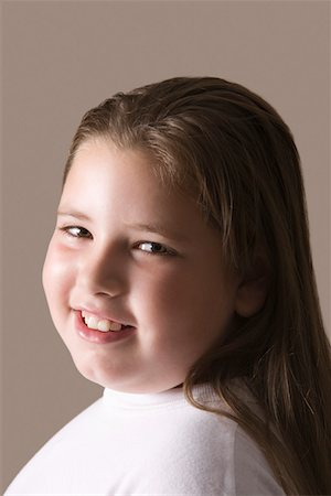 Overweight girl, smiling Stock Photo - Premium Royalty-Free, Code: 693-03314510