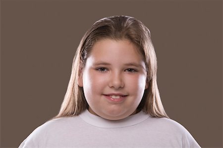 Overweight girl, smiling Stock Photo - Premium Royalty-Free, Code: 693-03314511
