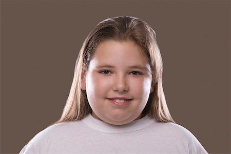 Overweight girl, smiling Stock Photo - Premium Royalty-Free, Code: 693-03314511