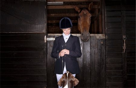 Horse rider with dog and horse at stable Stock Photo - Premium Royalty-Free, Code: 693-03315646